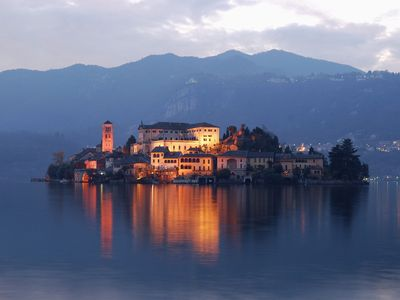 Exclusive 17th C waterfront Villa on San Giulio Island with garden & boat house.