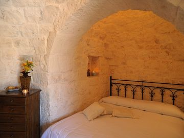 Double bed in the stone alcove