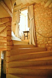 Domme castle rental - Winding up the stone staircase