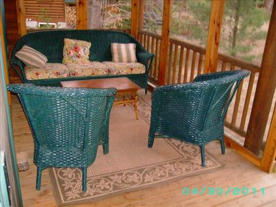 Spacious rear screen porch with wicker, front porch has wicker, rockers, & bench
