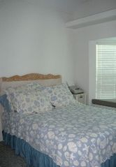 Corpus Christi house photo - Downstairs bedroom with a queen bed, HDTV, and window seat