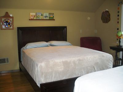 Queen and full size beds with private balcony looking over Shasta Lake.