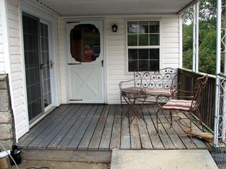Asheville house photo - Covered porch with sliders from guest bedroom and door from sitting room.