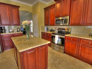 Champions Gate villa photo - Large gourmet kitchen with granite counters and island, brand new appliances