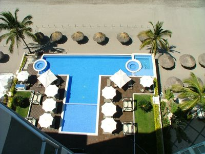 Pool area as viewed from Terrace. Roped area/palapas for private use of guests