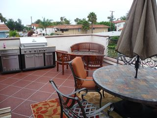 San Clemente condo photo - 17x 20 oversized patio for dining and entertaining. New BBQ island with frig etc