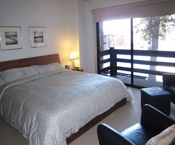 Master bedroom with California king bed and access to lake facing balcony