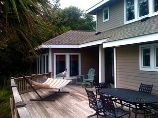 Bald Head Island house photo - Another view of the deck--notice the dining table with the rocking swivel chairs