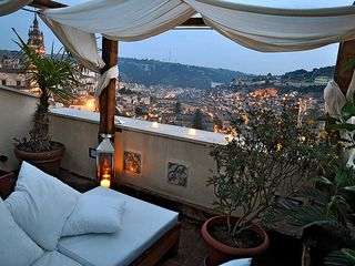 Modica house photo - The magic night view from the secluded rooftop terrace overstanding Modica