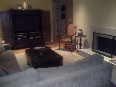 Living room with large plasma TV and fireplace. Very comfy.