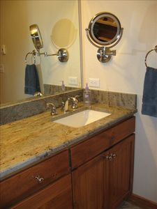 Master bath has double sink, make up mirror, oversize steam shower, heated floor
