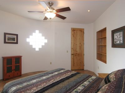 2nd BR w/ queen bed, glass block window, add'l window w/ mountain views