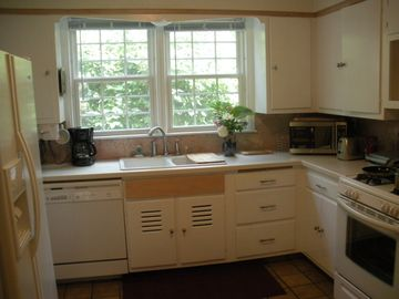 Kitchen w/ Corian countertop, marble, convection oven, fridge with ice and water