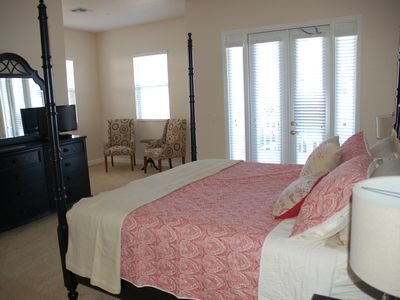 Huge Master bedroom with sitting area, private walkout to balcony with rockers!