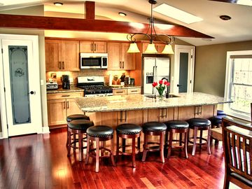 Large gourmet kitchen w/ island that seats 10 and another 8 at the dining table