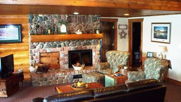 Family room over looking lake with fireplace & foosball