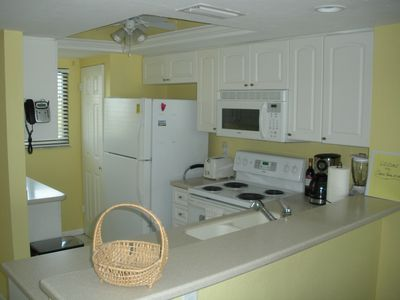 Kitchen with full size refrigerator,stove,dishwasher, and washer/dryer