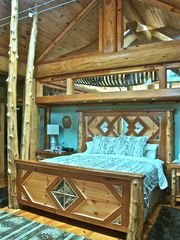 Cooperstown cabin photo - Handcrafted cherry and birchbark king size bed with 15' tall cedar tree