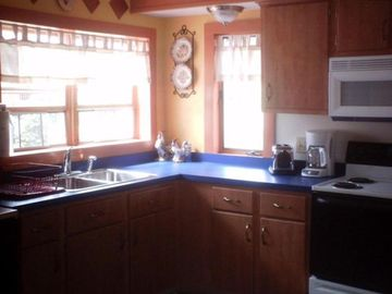 Large fully equipped eat in kitchen.
