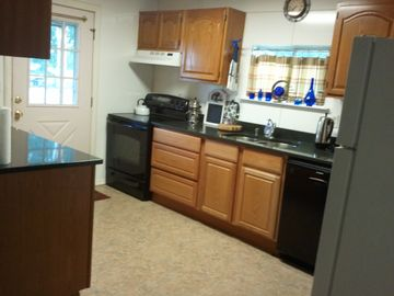 kitchen: electric stove, microwave & dishwasher, etc.