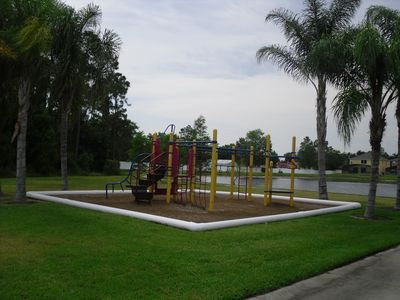 Children's play area with lake in background