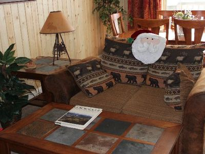 rustic love seat and slate coffee table