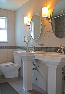 Custom Glass Tiles, double Kohler vanity, main bathroom