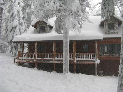Front of the cabin with last Winter's big storm!