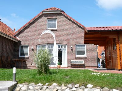 Family-friendly holiday home with a dock on the canals of Greetsiel