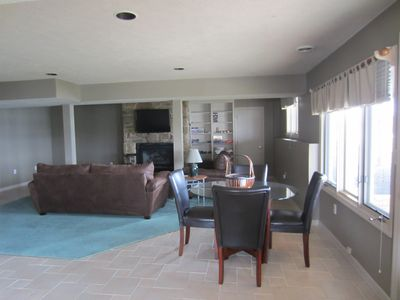 Lower level living area and game room.