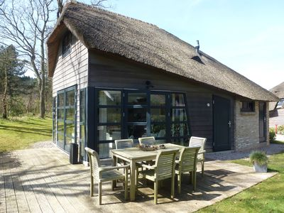 . Modern detached holiday home with a thatched roof, tastefully u