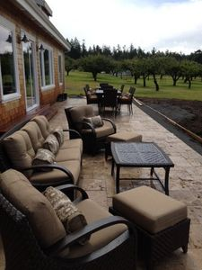 Huge 1,300SF travertine patio with outdoor furniture and 2 dining sets