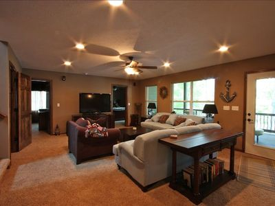 "Middle floor living room, 50"" flat screen TV, surround sound, DVD player"