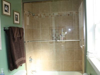 First floor bath with enclosed shower.