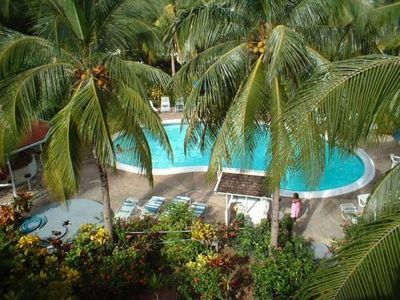 front balcony view. Villa is in small complex/ also kiddie pool & playground
