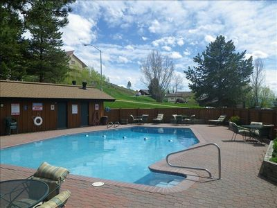 The pool is just steps from the back patio and is open June thru August.