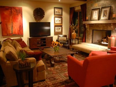 "Living room has plenty of comfortable seating, 60"" HDTV, fireplace"