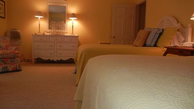 Another shot of the upstairs guest room with a pair of double beds