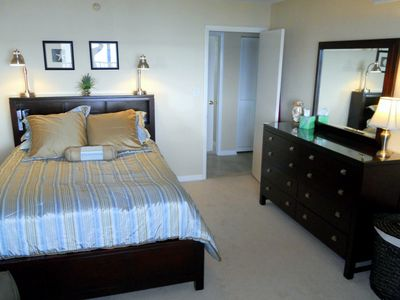 Guest room with walk-in closet and harbor view.