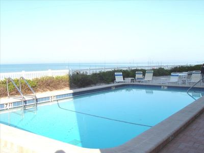 Beach front heated pool & surrounding lounge chair area lets unwind with a view.