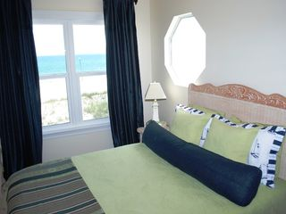 Gulf Shores house photo - West upstairs queen bedroom opens to beachfront porch, has TV, private bath
