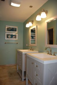 Master ensuite bath w/large walk-in shower, custom tile & double vanities