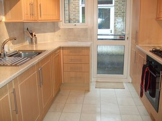 Greenwich apartment photo - Full sized family kitchen. Out of the door to the staircase to the garden