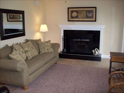 Living room with granite fireplace