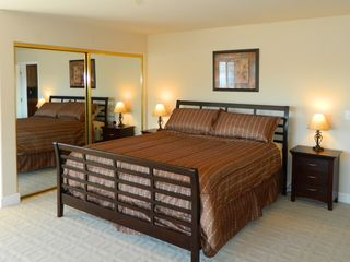Spacious master bedroom with king size bed and panoramic views of Clear Lake.