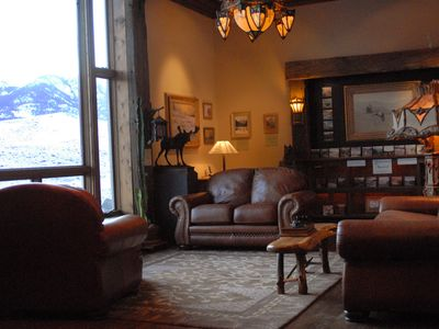 living area with large window looking out on Yellowstone Nat'l Park & the river