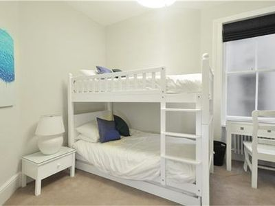 Spacious fourth bedroom with bunk beds