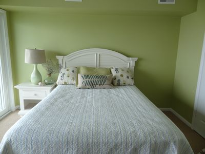 Second bedroom with queen bed with view of bay
