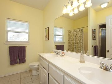 Guest bathroom with 1 shower/tub combo plus a large walk-in shower.