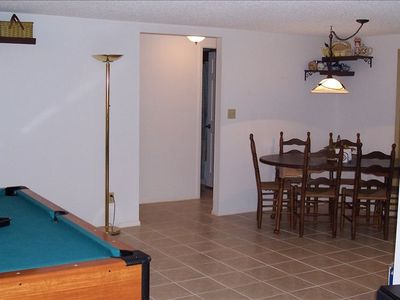 Plenty of room to gather around the dining table and play pool or ping pong!
